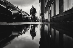 not amused at all (Zesk MF) Tags: bw mono zesk cologne x100f fuji street candid reflection water wasser strasse