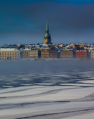 Foreground floes (snowyturner) Tags: stockholm sweden ice floes mist morning winter church gamlastam water cold buildings