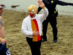Little Hands for a clownish wave at #INDYPLUNGE. (kennethkonica) Tags: indyplunge eaglecreekpark polarplunge specialolympics water lake midwest usa america fun hoosiers global random indianapolis indiana wet indy people winter canonpowershot canon trump potus clown