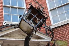 Dartford Lantern,5 (doojohn701) Tags: vintage classic lantern streetlighting black damaged vandalism light bulb frame windows glass entrance reflection sunlight dartford uk