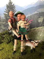 Tired little legs (Foxy Belle) Tags: doll caco miniature mountain goat outside diorama plants bavarian german traditional folk clothing costume green red white family children schleich kid bell 118