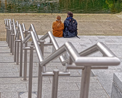 Killing Time (Geoff Henson) Tags: man woman couple people sitting steps handrail canal water london kingscross