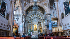 2018 - Mexico - Oaxaca - Basilica of Our Lady of Solitude (Ted's photos - Returns late Feb) Tags: 2018 cropped mexico nikon nikond750 nikonfx oaxaca tedmcgrath tedsphotos tedsphotosmexico vignetting basilicaofourladyofsolitude oaxacabasilicaofourladyofsolitude basilicaofourladyofsolitudeoaxaca church churchinterior basílicadenuestraseñoradelasoledad oaxacabasílicadenuestraseñoradelasoledad basílicadenuestraseñoradelasoledadoaxaca unesco unescoworldheritagesite arches pews seating seats columns oaxacachurch oaxacacatholicchurch catholicchurchoaxaca