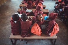 The Cute Little Things (u c c r o w) Tags: children students portrait class education africa maasai tanzania purple love lovely school