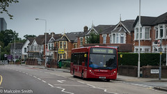 Route 396 Ilford (M C Smith) Tags: bus red route 396 ilford essex shops houses buildings road traffic arrow lines white yellow letters numbers symbols posts lampposts flats trees green sky blue junction bins busstop busshelter junctions railings wall kerb pavement brick aerials