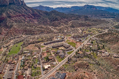Aerial View of Springsdale, Utah just outside of Zion National Park (JacobBoomsma) Tags: nature panorama sandstone rocks landscape utah solitude slopes scenic us ut dale american worn exterior stone northamerica nationalpark unitedstatesofamerica southernutah outdoors desert peaks sandstoneformations canyons zionnationalpark contours usa coloradoplateau naturalmonuments northamerican erosion panoramic america landforms unitedstates geological rural geology buttes aerial drone above plane