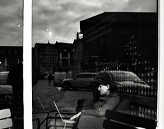 Reflections (Bury Gardener) Tags: burystedmunds bw blackandwhite britain monochrome mono england eastanglia uk people peoplewatching folks nikond7200 nikon suffolk streetphotography street streetcandids snaps strangers candid candids 2019 buttermarket