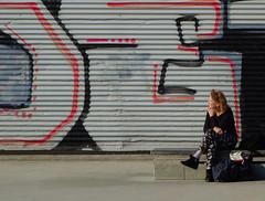 In the street (chrisk8800) Tags: street woman graffitti constructionwall barcelona