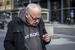 Nicotine (Leanne Boulton) Tags: portrait urban street candid portraiture streetphotography candidstreetphotography candidportrait streetportrait streetlife old elderly man male face expression mood feeling emotion stubble smoke smoker smoking cigarette nicotine stains hands fingers moustache tone texture detail depthoffield bokeh naturallight outdoor light shade city scene human life living humanity society culture lifestyle people canon canon5dmkiii 70mm ef2470mmf28liiusm color colour glasgow scotland uk