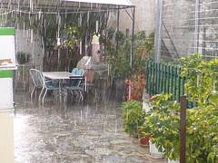 it's raining!!   P1070146 (amalia_mar) Tags: itsraining rain winter homeyard flowerpot table chairs rainshowers