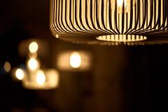 Caged Lights (ckilger) Tags: summiluxm11450asph leicam10 nacht lichter farbe color warschau lampen beleuchtung restaurant gitter