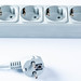 Extension cord with sockets on white background