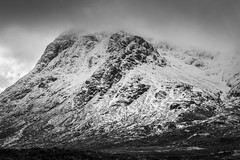 Low clouds over Etive Moor (joshkfabian) Tags: curious bliss detail highlights shadows lightanddark emotional feeling explore hiking adventures blackandwhitelandscape lamdscape exposure ndfilter filter darkclouds badweather beginner 35mmdx nikon mysterious moody weather clouds background sharp cliffs rockies rocks highlands glencoe scotland texture whiteandblack blackandwhite white black winter snow storm mountain