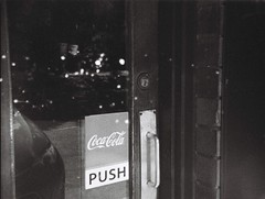 Push door for Coca-Cola (Matthew Paul Argall) Tags: ansco50 fixedfocus 110 110film subminiaturefilm lomographyfilm 100isofilm blackandwhite blackandwhitefilm grainyfilm cocacola coke advertising advertisement plasticlens toycamera