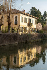 Old buildings along the canal Martesana, Milan (clodio61) Tags: europe italy lombardy march martesana milan naviglio architecture building canal color day exterior historic house old outdoor photography reflection typical water winter