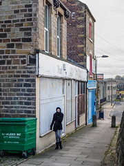 Dewsbury 010 (Peter.Bartlett) Tags: dumpster unitedkingdom people streetphotography olympuspenf westyorkshire colour woman peterbartlett shutter girl walking candid uk m43 microfourthirds urban kirklees backstreets sign dustbin bollard bin dewsbury england gb