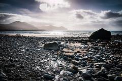 Aberdesach (lowribearmanphotography) Tags: beach coast dramatic rocks sea sky mountains seascape landscape moody wales cymru aberdesach tones stones