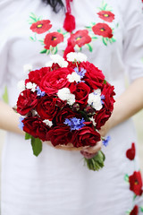 Wedding bouquet of red roses (mallivan) Tags: decoration rose floral celebration wedding embroidery ethnic traditional carnation bride love bouquet flower bridal romantic background arrangement elegance bunch white blossom beautiful marriage beauty nature green color occasion closeup day married female dress romance petal fresh red arm woman hand leaf plant colorful valentines style ukraine ukrainian poppies cornflower engagement