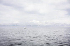 Sailboat and Tender (jessicalowell20) Tags: atlanticocean blue clouds coastal horizon maine mainecoast monochromatic ocean offshore sailboat serene silver summer tender white