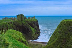 Dunnottar Castle (Simone If) Tags: dunnottar castle aberdeen aberdeenshire sea hill cliff scotland mountain seashore seascape landscape nature hiking uk united kingdom green blue waves person back travel photograpgy film explore cinematography canon 1100d eos colors