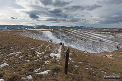 Following the Fenceline (kevin-palmer) Tags: sheridan wyoming soldierridge february winter snow snowy afternoon clouds hills nikond750 tamron2470mmf28 bighornmountains grass grassy fence posts