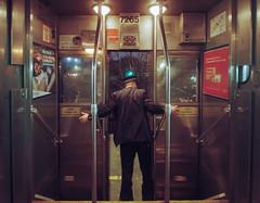 Metra Train Conductor Holding Doors (Jovan Jimenez) Tags: canon eos rebel t2 tokina 1116mm lomography 800 35mm film atx 116 dx ii f28 lomo 300x kiis7 train metro station holding metra conductor doors grain