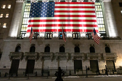 The fearless girl takes on NYSE (wwward0) Tags: americanflag broadst building cc fidi flag illuminated manhattan newyorkstockexchange night nyc nyse outdoor sidewalk statue street wwward0