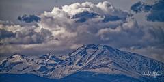 Long's Peak, As Seen From Denver (dcstep) Tags: dsc7298dxo sonya9 fe400mmf28gmoss fe20xteleconverter handheld cherrycreekstatepark colorado usa greenwoodvillage allrightsreserved copyright2019davidcstephens dxophotolab221 nature urban urbannature mountain longspeak rockymountains snowcapped clouds