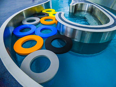 Lining Up For Swimming Lessons (Steve Taylor (Photography)) Tags: ring blue black grey orange silver metal rubber water newzealand nz southisland canterbury christchurch northnewbrighton shiny curve pool swimmingpool taioraqeiirecreationandsportcentre