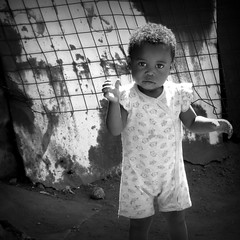 Difficult living conditions (__ PeterCH51 __) Tags: soweto township sowetotownship johannesburg gauteng southafrica za people localpeople kid portrait social reportage documentation socialreportage socialdocumentation streetlife dailylife bw blackandwhite monochrome square peterch51 poor difficult livingconditions