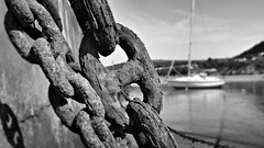 Only as strong (Matt West) Tags: chain link sea boat bay wales harbour ocean rust rusty iron beach blackandwhite bw