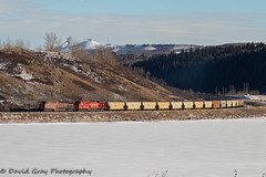 Potash on the Move (Going Trackside Photography) Tags: canadian pacific railway canada alberta calgary bow river frozen potash sunny train cp cpr rail railroad