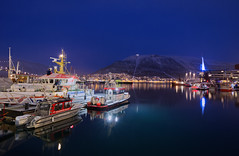 Tromso Harbour (Rob McC) Tags: boats harbour waterfront night lights water reflections landscape tromso norway mountains bluehour