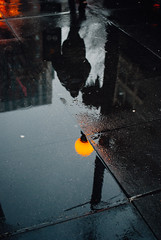 Somewhere between morning and night. (ewitsoe) Tags: nikon seattle street travel washngtonstate winter erikwitsoe erikwitsoecom snow lookingdown reflection city man silhouette lateafternoon water puddles drops rain reflect light cityscape
