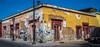 2018 - Mexico - Oaxaca - Reforma y Constitución (Ted's photos - Returns late Feb) Tags: 2018 cropped mexico nikon nikond750 nikonfx oaxaca tedmcgrath tedsphotos tedsphotosmexico vignetting wideangle widescreen building streetscene street streetlamp streetlight