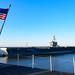 USS Abraham Lincoln transits past USS Harry S. Truman.