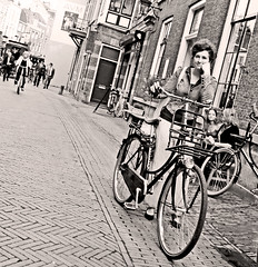 I See You (kirstiecat) Tags: bicyclist woman beautiful monochrome utrecht netherlands dutch blackandwhite noiretblanc female stranger canon street summer beautifulstranger classic postcard timeless