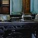 Vintage typewriters and radio on top of steel table