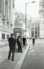 Photo of a Photo 1 (Myahcat) Tags: london 35mm film bw blackandwhite kosmophotomono mono yashica yashicafri winter street city inception photoofaphoto streetphotography phonebox tourists filmphotography westminster westminsterabbey