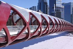 The Peace Bridge above the frozen Bow River, Calgary (Jon Dev) Tags: architecture infrastructure urban city ice snow shadow buildings alberta canada winter