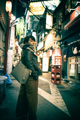 Young woman looking over shoulder in Japanese old Izakaya street (Apricot Cafe) Tags: imgr12294 asia asianandindianethnicities canonrf35mmf18macroisstm japan japaneseethnicity japaneseculture millennialgeneration shinjukuward sigma24mmf14dghsmart015 tokyojapan afterwork alley buildingexterior businesswoman capitalcities carefree casualclothing citylife coatgarment colorimage confidence coolattitude crossprocessed freedom fulllength illuminated independence lantern leisureactivity lifestyles lookingatcamera lookingovershoulder night nightlife nostalgia oneperson oneyoungwomanonly onlywomen outdoors people photography realpeople scarf shorthair street strong tourist tradition travel traveldestinations winter youngadult