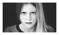 Angry Eyes (Erik de Klerck) Tags: eyes eye portrait portret girl blackandwhite zwartwit wit closeup headshot angry expression young longhair blond 200mm f2 nikon nikon200mmf2