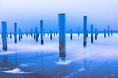 Mystic blue (Katja van der Kwast) Tags: 2019 the netherlands nederland petten palendorp beach strand sea zee waves golven palen poles blue hour blauwe uurtje water reflectie reflection ice ijs snow sneeuw