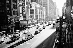 State Street (Crawford Brian) Tags: fuji trix kodak film analog chicago city urban illinois bw blackandwhite pointandshoot 35mm sign chicagotheater theatre street cars trucks shadow vanishingpoint grainy