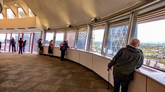 Observation deck inside Calgary Tower. (lhboudreau) Tags: calgary downtown tower calgarytower bowbuilding building buildings architecture city alberta street thebow skyscraper skyscrapers canada observation observationdeck people window windows inside indoor view viewing