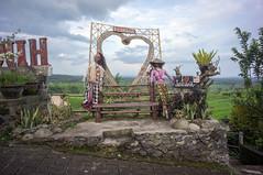 around Jatiluwih (kuuan) Tags: manualfocus mf voigtländer15mm cvf4515mm 15mm bali indonesia sonynex5n riceterace jatiliwuh tabanan view mountbatukaro sign love tourism puppets straw