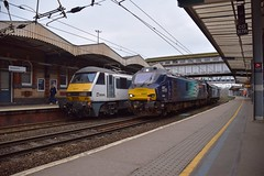 DRS bi-mode Locos 88003 & 88007 move through the centre road at Ipswich on a Norwich - Norwich via Tendring Peninsula diagram, as GA 90005 propels the 07.55 Liverpool St - Norwich service away. 27 03 2019 (pnb511) Tags: greateranglia trains railway greateasternmainline geml bimode diesel class88 loco locomotive train drs directrailservices track station platform footbridge ipswich