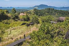 Bukit Tengkorak, Semporna. (Andy @ Pang Ket Vui ( shootx2 )) Tags: bukit hill tengkorak semporna fujifilm x100f wclx100ii wide conversion lens landscape green grasses ocean hut