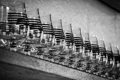 Meadery Glasses (tim.perdue) Tags: brothers drake meadery columbus ohio short north bar mead black white bw monochrome nikon d5500 nikkor 18105mm mono blackandwhite glasses glassware glass stripes logo wood shelf wall pattern repetition focus bokeh depth field dof