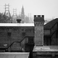 Chess Pieces (dmcbee1) Tags: rooftop fog clouds haze city town street art diffuse bw old sign elevated layers black white